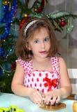 Little girl baking Christmas cookies stock photo
