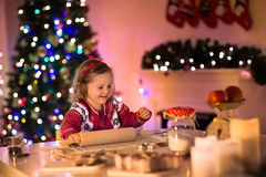 Little girl baking Christmas pastry. Stock Photo