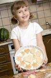Little girl baking cookies Stock Photos