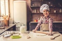 Little girl baking Stock Image