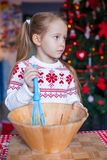 Little girl baking gingerbread cookies for Royalty Free Stock Image