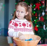 Little girl baking gingerbread cookies for Royalty Free Stock Photos