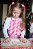 Little girl baking gingerbread cookies for Stock Photography