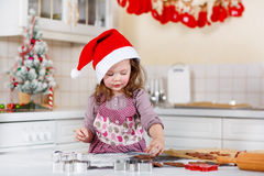 Little girl baking gingerbread cookies in domestic kitchen Royalty Free Stock Photography
