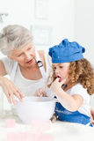A little girl  baking with her grandmother Royalty Free Stock Photos