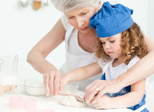 A little girl  baking with her grandmother Royalty Free Stock Photo