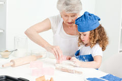 A little girl  baking with her grandmother Royalty Free Stock Images