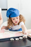 A little girl  baking with her grandmother Stock Photos