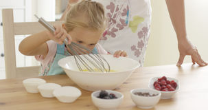 Little girl baking with her mother Royalty Free Stock Photo