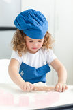 Little girl baking in the kitchen Stock Image