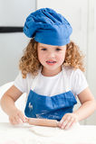 Little girl baking in the kitchen Royalty Free Stock Image