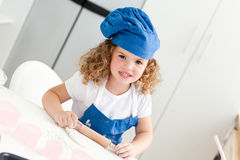 Little girl baking in the kitchen Stock Photography