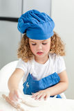 Little girl baking in the kitchen Stock Photos