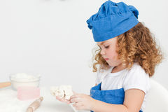 Little girl baking in the kitchen Royalty Free Stock Photos