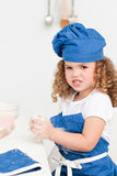 Little girl baking in the kitchen Royalty Free Stock Images