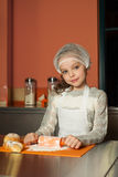 Little girl baking in the kitchen Royalty Free Stock Photography