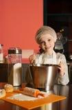 Little girl baking in the kitchen Stock Image