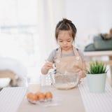 Little girl baking stock photography
