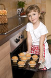 Little girl baking muffins Royalty Free Stock Images