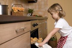 Little girl baking muffins Stock Photography