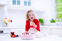 Little girl baking strawberry pie Royalty Free Stock Photos