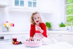 Little girl baking strawberry pie Royalty Free Stock Photos