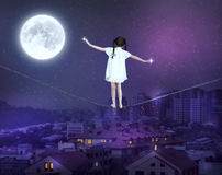 Free Little Girl Balancing On A Tightrope Royalty Free Stock Photo - 90151905
