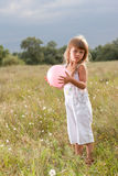 Little girl with ball Stock Photo