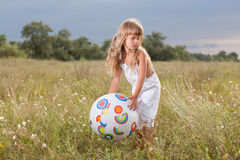 Little girl with ball Stock Photos