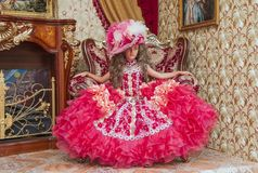 Little girl in a ball gown Stock Images
