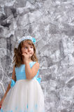 Little girl in ball gown indoors Royalty Free Stock Photography