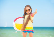 Little girl with a ball. Little girl playing on beach with a ball Stock Photos