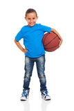 Little girl ball. Pretty little girl posing with a ball on white background Stock Image