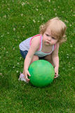 Little Girl with Ball Stock Images