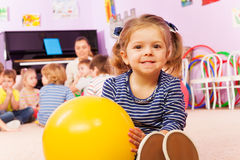 Little girl with ball sit in developmental class Stock Images