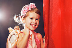 Little girl ballerina ballet dancer on stage in red side scenes Stock Images