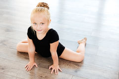 Little girl ballerina stretching in dance studio Stock Photography