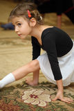 Little girl in ballet class sits on floor Stock Photos