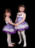 Little girl ballet dancers holding hands. Isolated Royalty Free Stock Images