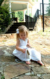 Little Girl and Ballet Slippers royalty free stock photography