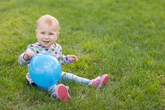 Little girl with a ballon Stock Photos