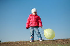 Little girl with a balloon Royalty Free Stock Images