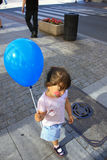 Little girl with balloon. In the city Stock Photos
