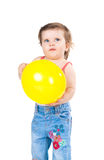 Little girl with a balloon Stock Image