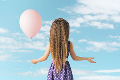 Little girl with a balloon Stock Photo