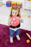 Little girl with balloon in the room Royalty Free Stock Images