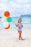 Little girl with balloons at beach Royalty Free Stock Photography
