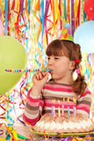 Little girl with balloons and birthday cake Stock Photography