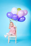 Little girl with balloons on blue background Stock Image