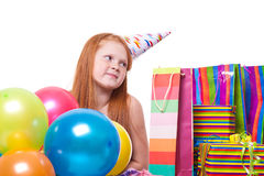 Little  girl with balloons and gift box Stock Photos